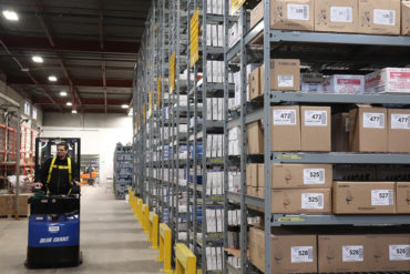 Widespan bulk high bay boltless shelving for order picker and distribution storage of automotive parts wire deck