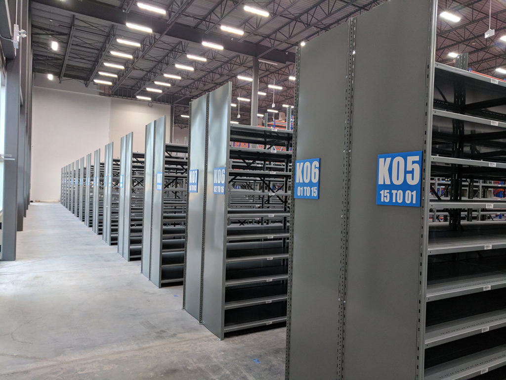 open shelving with welded side panels 1 level that can become 2 level high bay picking using metal shelving for parts and toolstorage