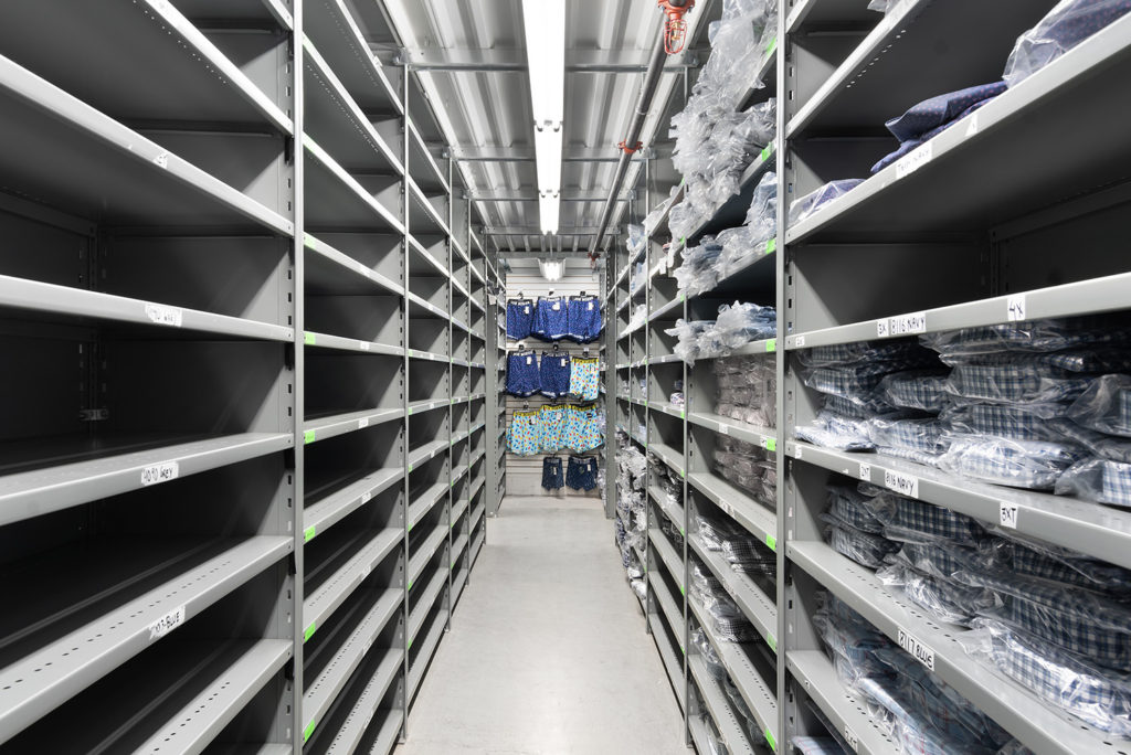 closed shelving for clothing distribution adjustable shelves