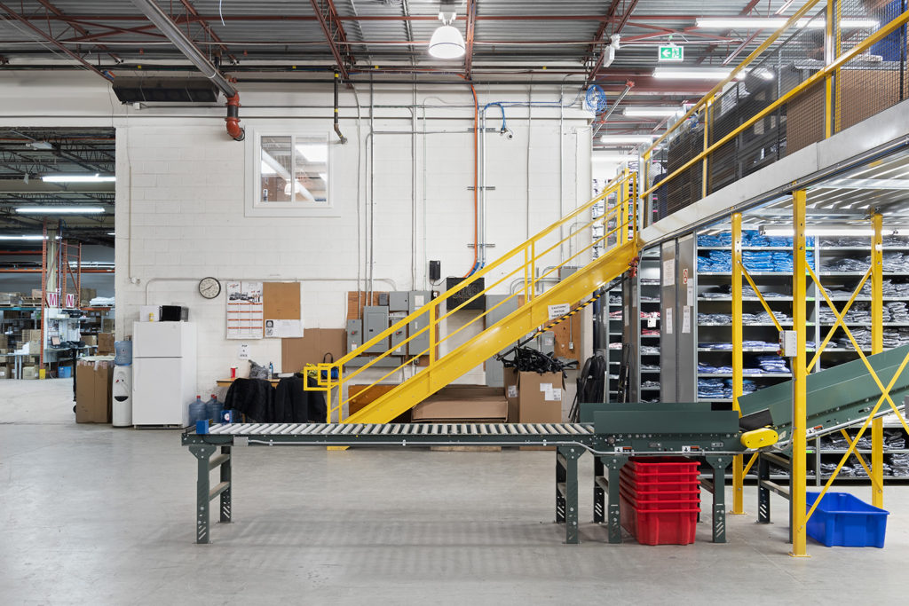 2 level closed shelving supported structural floor section, conveyor and staircase to code with stamped engineering drawing