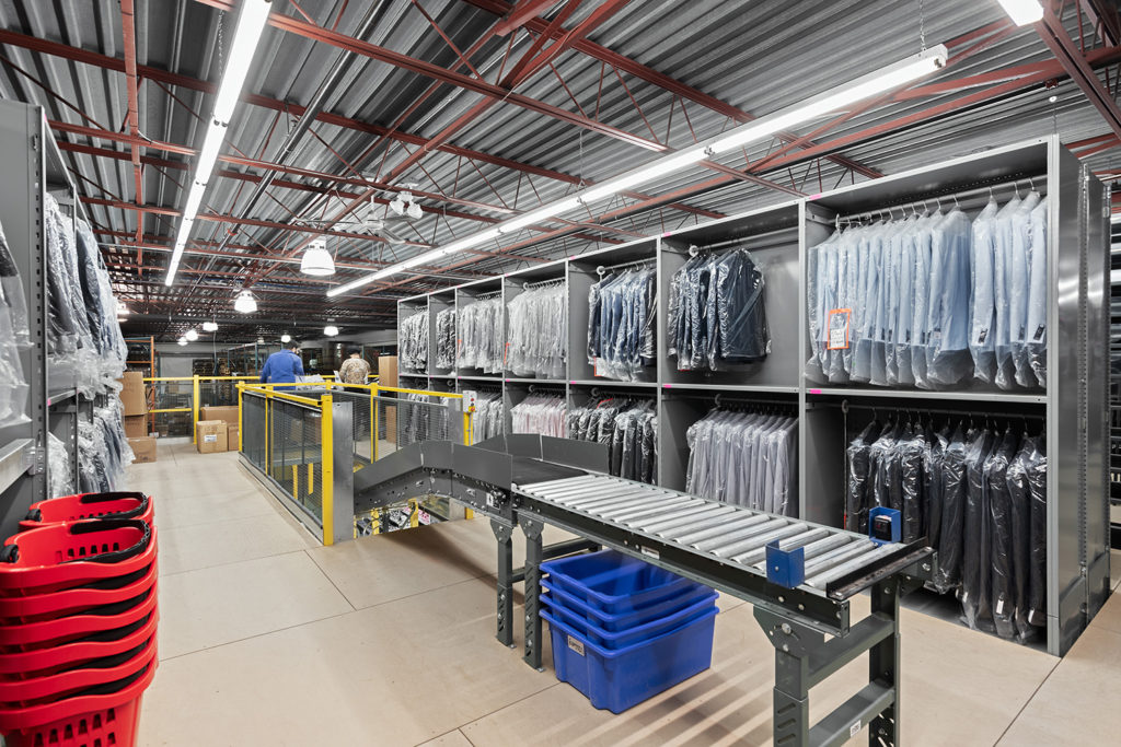 closed shelving for clothing distribution structural support for conveyor system or drop chutes manufactured in house