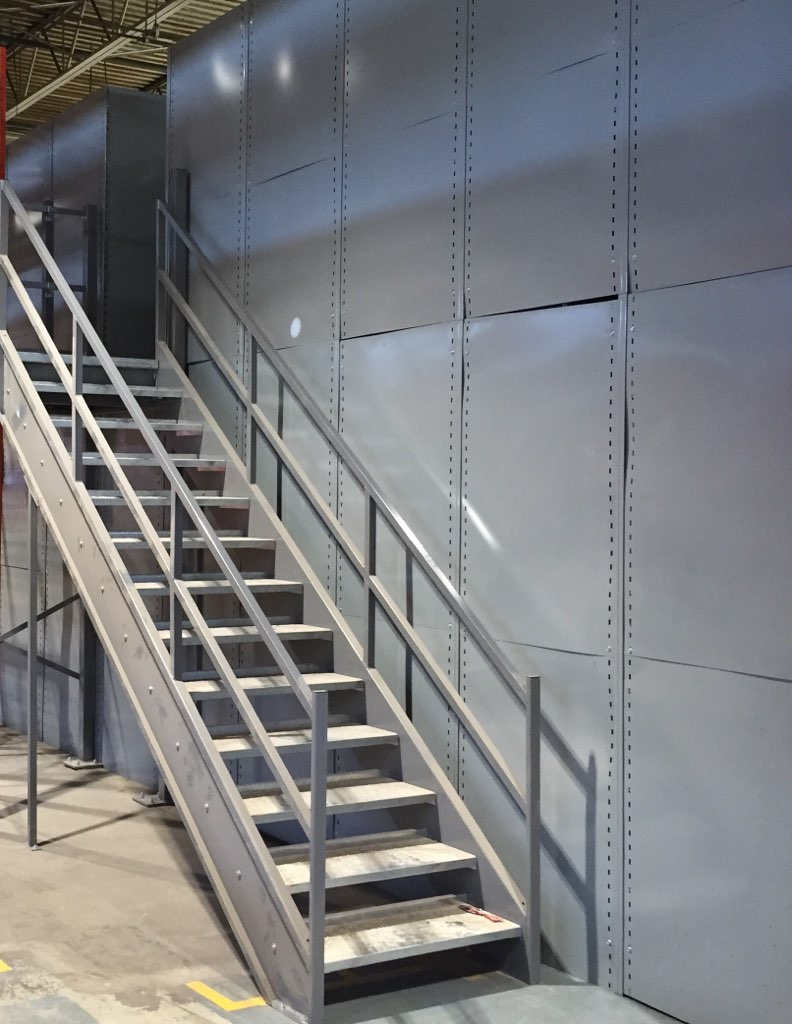 custom and standard staircases for multi level shelving systems made and designed in house