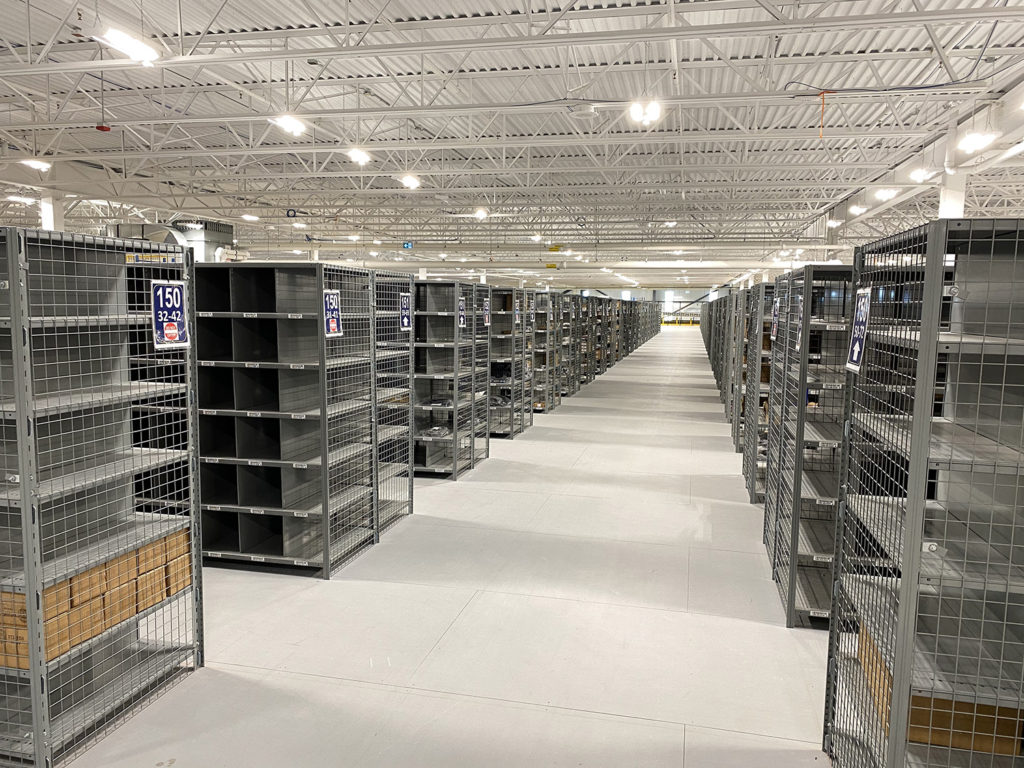 Interlok steel shelving for pharmaceutical order picking wire mesh side panels