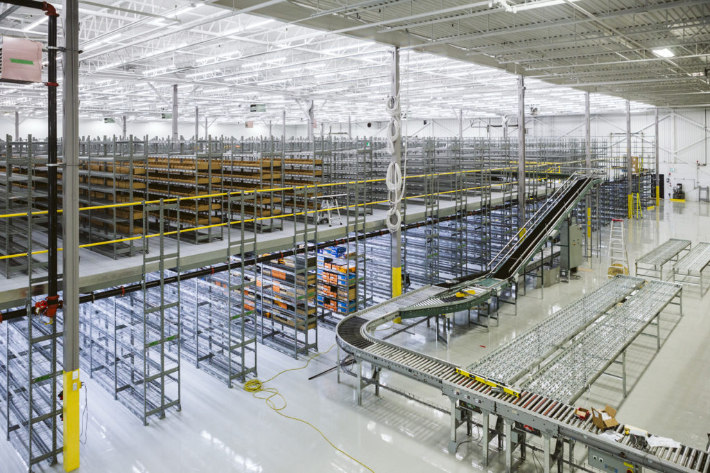 Widespan bulk multi level shelving supported mezzanine with integrated conveyor structural support for e commerce