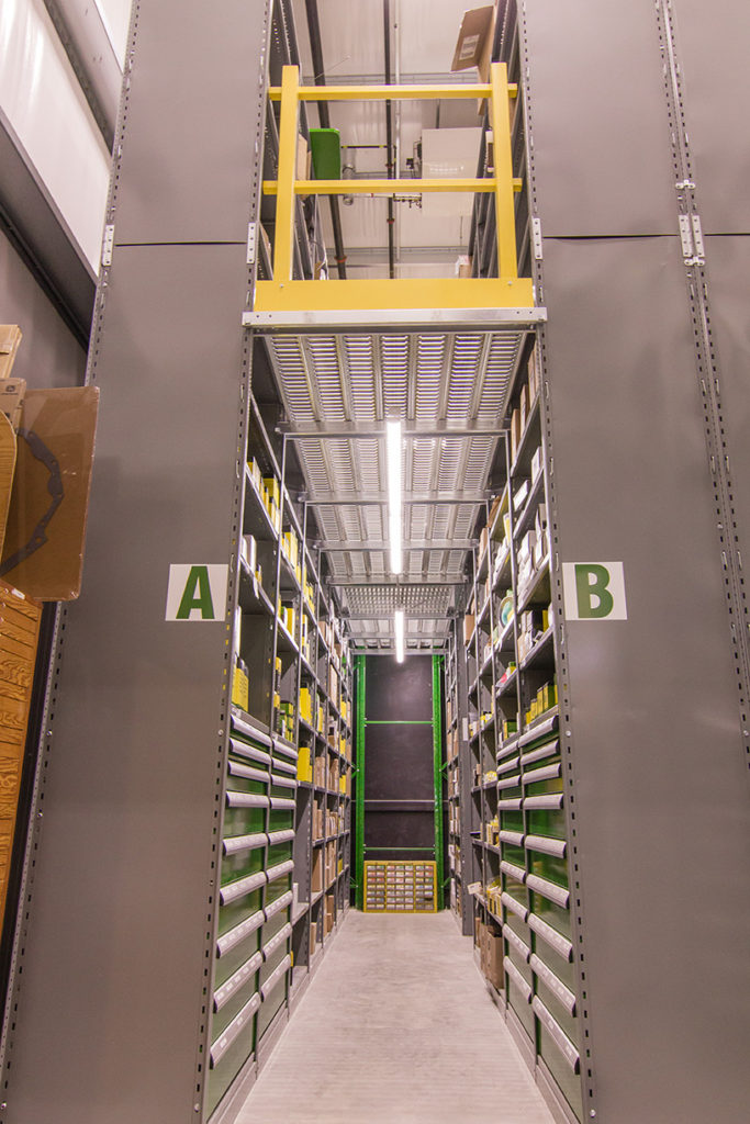 modular drawers in multi level shelving with floor for equipment parts